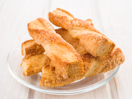 danish puff pastry: Twisted pastry on white wooden base Stock Photo