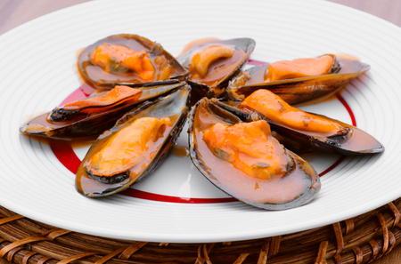 mussel: Star mussel sauce on plate Stock Photo