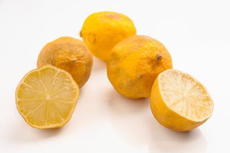 spoilage: rotten lemons on white base Stock Photo