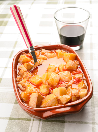 potato cod: potato stew with cod and glass of wine