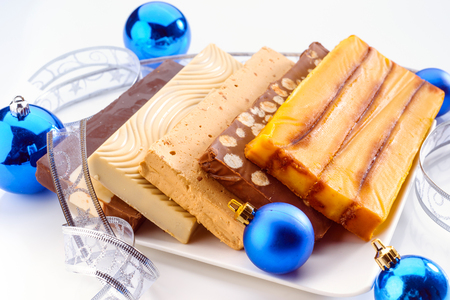nougat: tablets of Christmas nougat with Christmas decorations Stock Photo