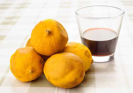 spoilage: rotten lemons and wine glass on tablecloth