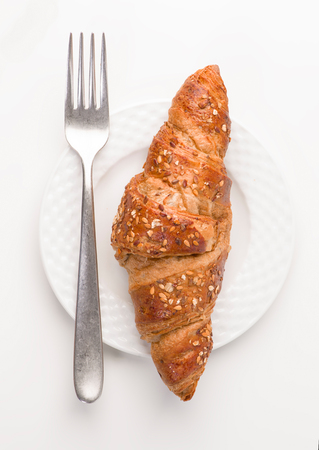 aerial view of a croissant cereal dish, on white background