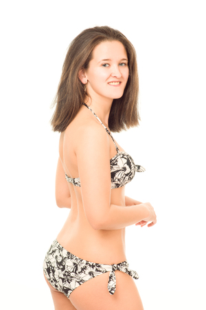 unsightly: young woman in bikini poses in studio