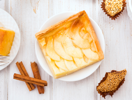 aereal: overhead making apple pie on wooden table with breakfast