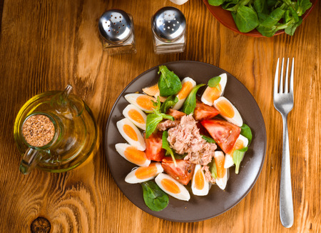 Vertical making homemade Mediterranean salad with olive oil on porcelain plate Stock Photo