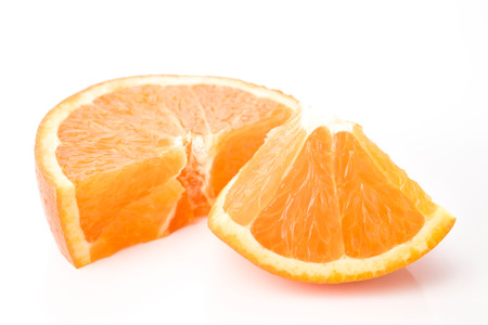 portions: portions of orange on white background Stock Photo