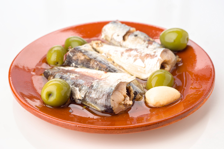 macerated: marinated sardines on clay plate Stock Photo