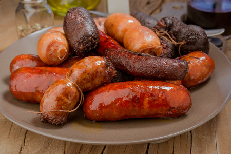 Lots of Spanish sausage roasted in an earthenware dish