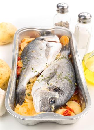 dorada: dorada raw fish ready to be cooked in aluminum tray