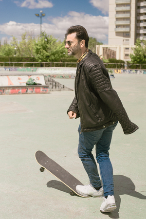 rejuvenated: He mature young man again, and riding skateboard