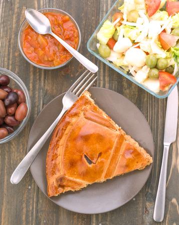 ration: chunk of pie stuffed with tuna, on wood