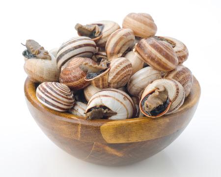 uncooked escargot in wooden bowl