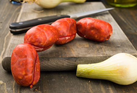 rustic: Spanish raw sausages on rustic wooden table Stock Photo
