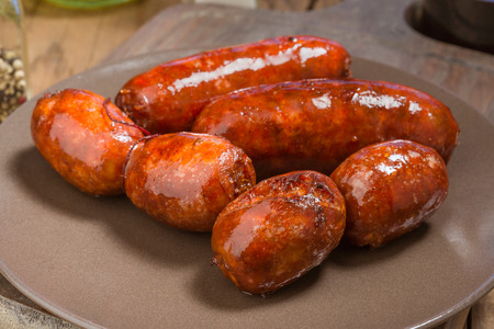 iberian: several Iberian sausages grilled in porcelain dish