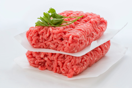 ration: minced meat block isolated on white
