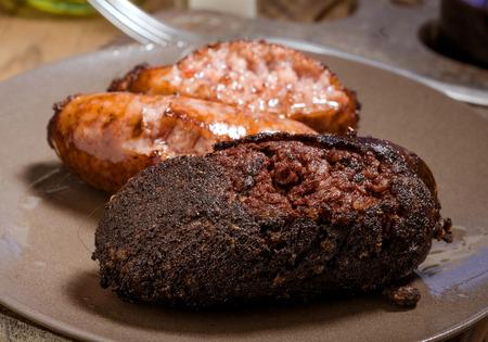 white sausage: sausage and white sausage baked in earthenware dish