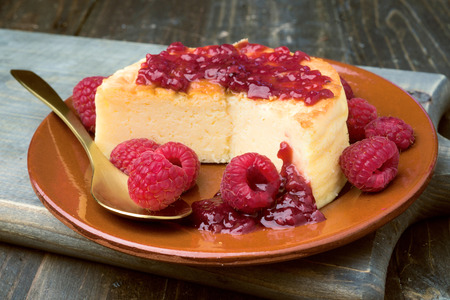 cheesecake with jam on wooden table lackluster Stock Photo
