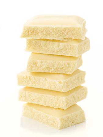 equilibrium: stack chocolate pieces in equilibrium; on white background