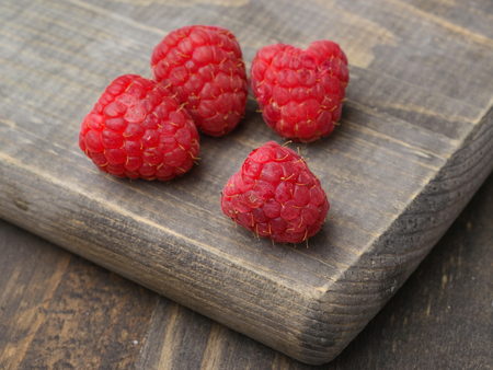 tarnished: ripe raspberries on wood lackluster Stock Photo
