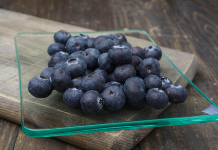 tarnished: Ripe blueberries, on lackluster wood