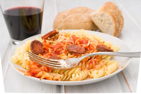 homemade pasta stew with chorizo on wood