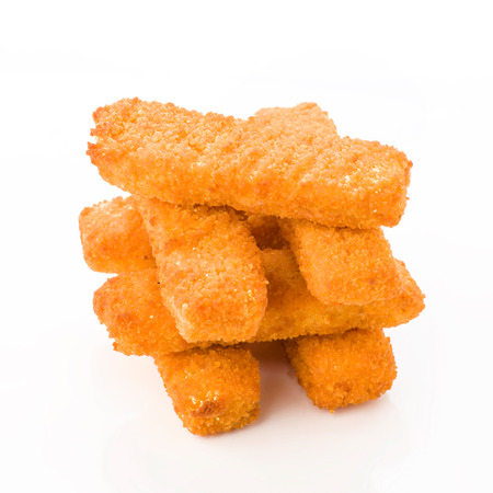 breaded: tower breaded fish sticks isolated on white Stock Photo