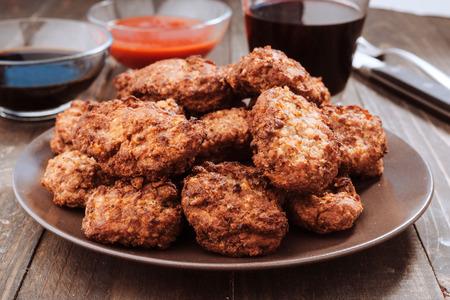 mini burgers on gray earthenware dish Stok Fotoğraf