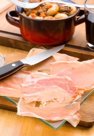 lunch tray: Spanish jamon appetizer on wooden classic