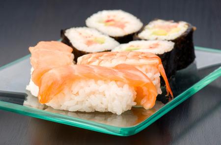 group of Japanese sushi on glass tray