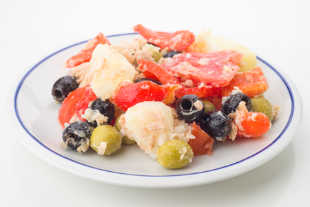 ration: summer salad on white china plate isolated
