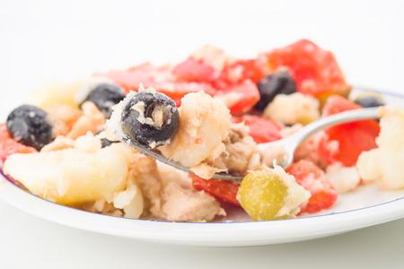 salad fork: macro shot of summer salad fork on dish Stock Photo