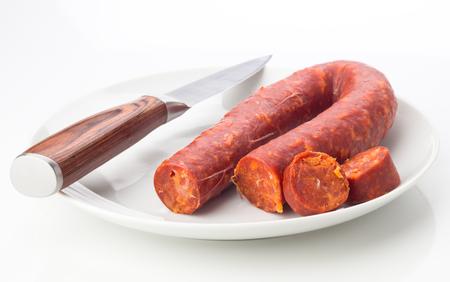 ration: Spanish chorizo dish isolated on white