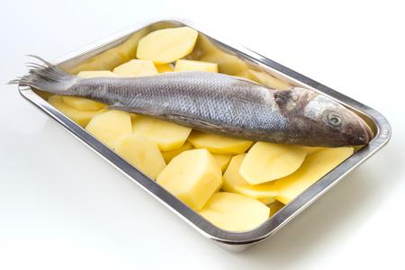 sheet steel: sea bass on potato wheels on cookie sheet steel isolated