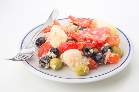 potato salad on plate with fork isolated
