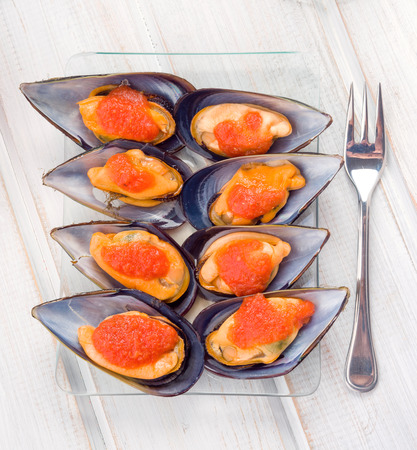 galician: Aerial making Galician mussels in glass tray