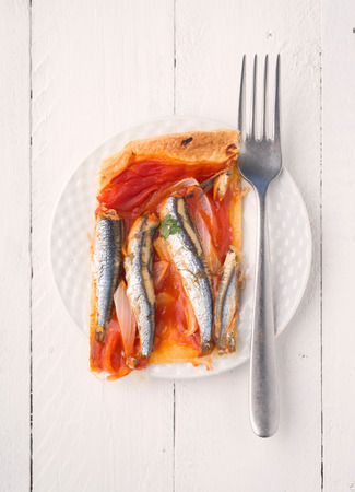 ration: aerial shoot shot of baked sardines ration on puff pastry with fork
