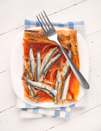 ration: overhead shot of baked sardines ration on puff pastry with fork