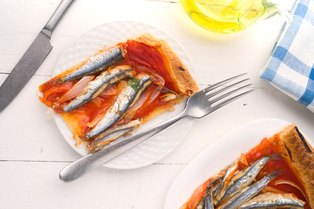 ration: overhead shot of ration sardines baked puff pastry on wooden Stock Photo