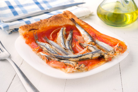 sardines: shot of sardines baked puff pastry on wooden Stock Photo
