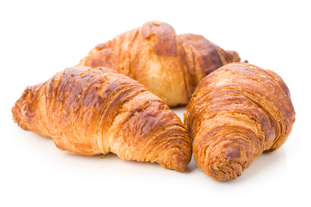 tender: three tender croissants, isolated on white