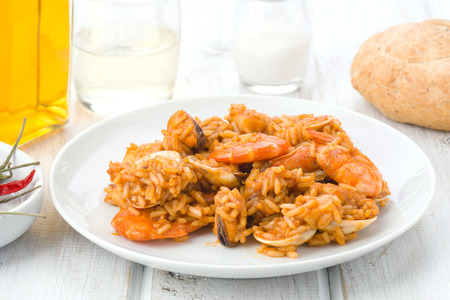 ration: ration of rice with seafood in white plate on  wood table Stock Photo