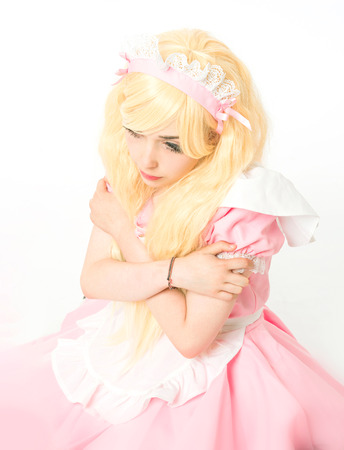 manga girl: characterized maid manga girl makeup gesticulating in the studio, on white background