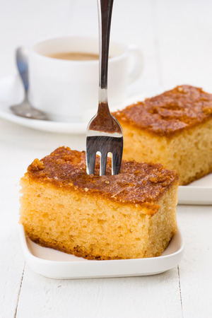 breackfast: sweet cake with coffee on white table