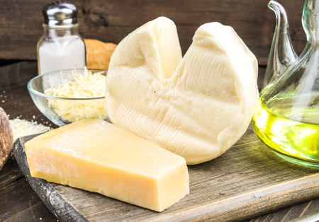 ovine: two pieces of cheese and other ingredients on wood Stock Photo