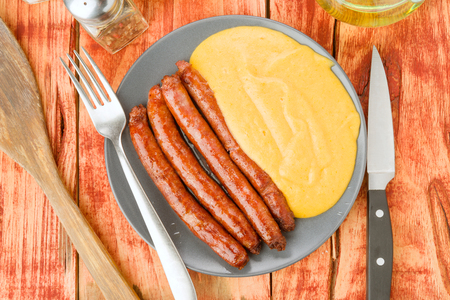 healt: sausage dish with vegetable puree in rustic wooden board
