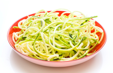 plate of raw zucchini spaghetti on white background Stok Fotoğraf