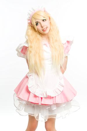 satin dress: maid manga gesticulating in the studio, on white background Stock Photo