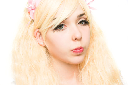 whithe: characterized portrait manga girl makeup in the studio, on white background Stock Photo