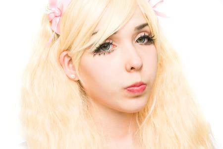 manga girl: characterized portrait manga girl makeup in the studio, on white background Stock Photo